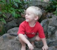 Boy Playing on the Rocks