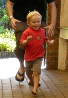 Running boy with stick
